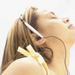 Profile of womlistening to music with headphones — Stock Photo #13233009