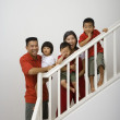Stock Photo: Portrait of Asian family on stairs