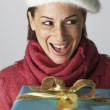 Royalty-Free Stock Photo: Young woman receiving gift