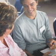 Young man conversing with woman — Stock Photo