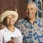 Portrait of elderly couple smiling — Stock Photo