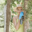 Young woman wearing gardening gloves — Stock Photo