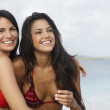 South American women hugging at beach — Stock Photo