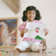 Young girl showing off her drawing — Stock Photo #13233121