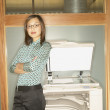 Stock Photo: Businesswomleaning on copy machine