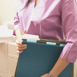 Midsection of businesswoman with files — Stock Photo