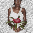 Portrait of African woman holding King Protea flower — Stock Photo #13233161