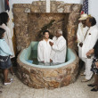 Adult baptism in church - Stock Photo