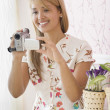 Hispanic womholding video camera — Stock Photo #13233165