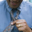 Man adjusting tie — 图库照片