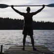 Stock Photo: Young mholding canoe oar