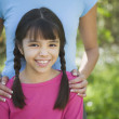 Hispanic girl smiling outdoors — Stock Photo