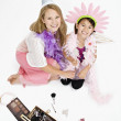 Studio shot of mother and daughter playing dress up — Stock Photo #13233275