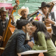 Stock Photo: Young couple with Mariachi band