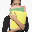 Portrait of businesswoman holding files — Stock Photo