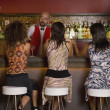 Royalty-Free Stock Photo: Hispanic women sitting at bar