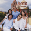Hispanic friends with cathedral in background — Stok fotoğraf