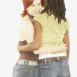 Studio shot of female couple hugging — Stock Photo