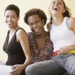 Man with two women laughing — Stock Photo