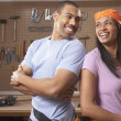 Couple laughing in workshop — Stock Photo