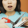 Stock Photo: Asiwomcutting up credit card