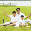 Stock Photo: Father playing croquet with sons