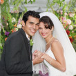 Stok fotoğraf: Newlywed couple smiling for camera