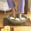 Stockfoto: Womsoaking her feet in bowl of water
