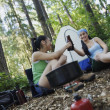 Stock Photo: Women relaxing at campsite