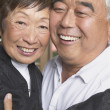 Senior Asian couple hugging and smiling — Stock Photo