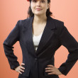 Portrait of businesswoman posing with hard hat — Foto Stock