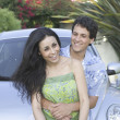 Portrait of young couple with car — Stock Photo