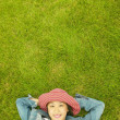 Portrait of womlaying in grass — Stock Photo #13233513