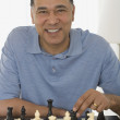 Stock Photo: Africmplaying chess