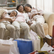 Three generations of African women resting on sofa — Stock Photo