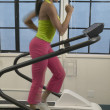 Side view of woman running on treadmill — Stock Photo