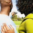 Stock Photo: Africcouple taking own photograph