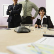 Multi-ethnic businesspeople at conference table — Stock Photo
