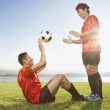 Two soccer players playing catch with ball — 图库照片
