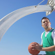 Stock Photo: Hispanic man playing basketball