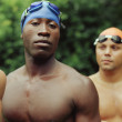 Foto Stock: Multi-ethnic male swimmers outdoors