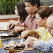 Stock Photo: Family eating at the table