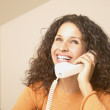 Businesswoman smiling while talking on phone — Stock Photo