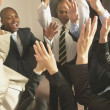 Stock Photo: Business cheering with hands raised