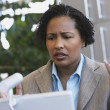 African American businesswoman with laptop — Stock Photo