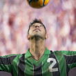 Stock Photo: Soccer player heading ball
