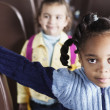 Portrait of girls on school bus - Stockfoto
