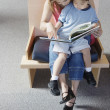 Woman reading to boy - Stock Photo