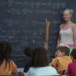 Rear view of classroom looking at teacher — Stock Photo