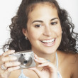 Stock Photo: Young woman using a digital camera